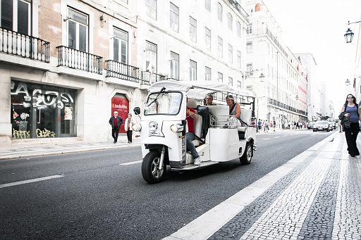 Tuk-tuk with passengers